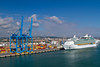 A container loading facility and a cruise ship at the port of Civitavecchia near Rome Italy.