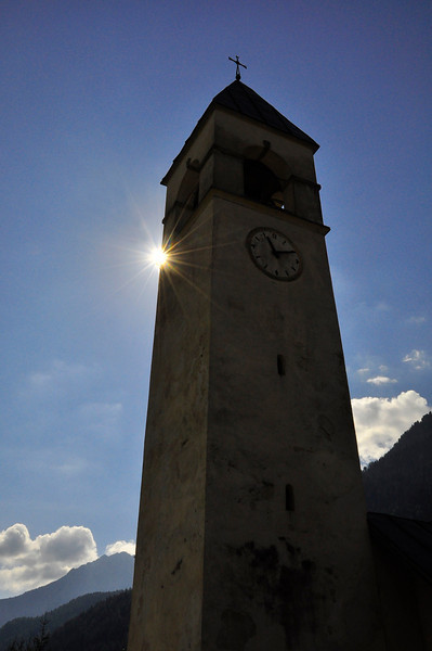 sunstar with San Vito di Cadora clocktower