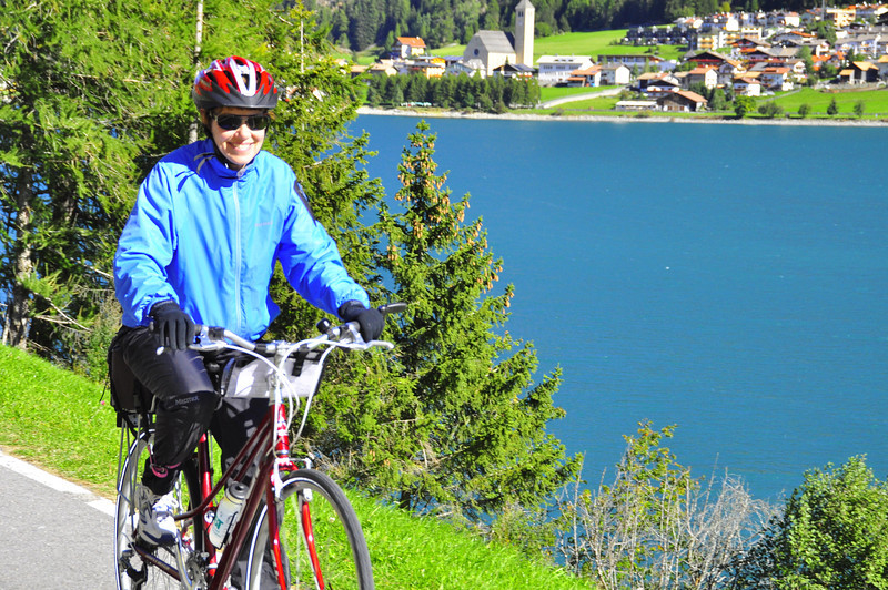 Cynthia along Lake Resia with Curon in the back
