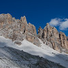 View of hikers along a distant ridge from the trail to Forcella Col dei Bos