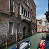 Tourists and supply boats navigating Venice canals