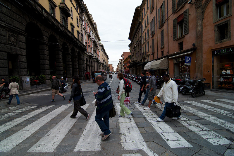 Crossing the streets of Bologna.