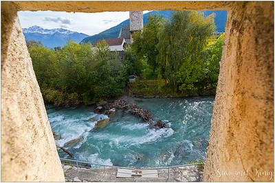 Having a peek at the Mühlbach creek, diverted from the Etsch (Adige river) from the gate tower