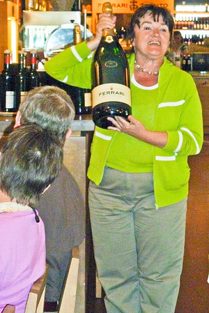 Mara explaining different sizes of sparkling champagne
