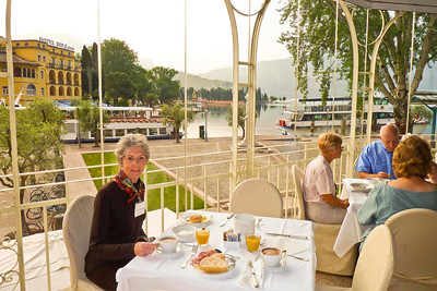 Joyce enjoying breakfast at Hotel Europa in Riva del Garda