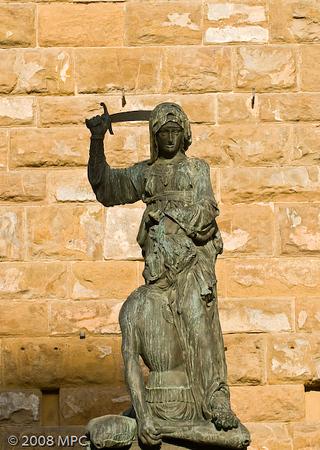 Donatello's Judith and Holofernes.  This is a copy, the original is inside the Pallazzo Vecchio