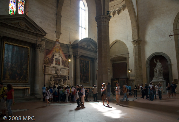 People gathering around Michelangelo's tomb.  The tomb was designed by Michelangelo himself.