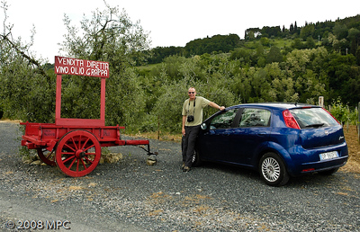 In the US you can grab a hot dog roadside.  Near San Gimignano you can get grappa!  Check out our little Fiat Punto!