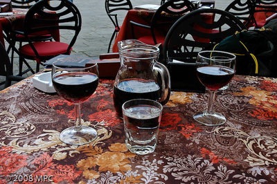 Having lunch in the Piazza Anfiteatro in Lucca with a carafe of red wine.