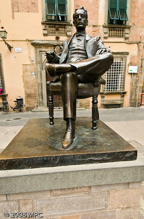 a statue of the great opera composer Giacomo Puccini, born in Lucca.