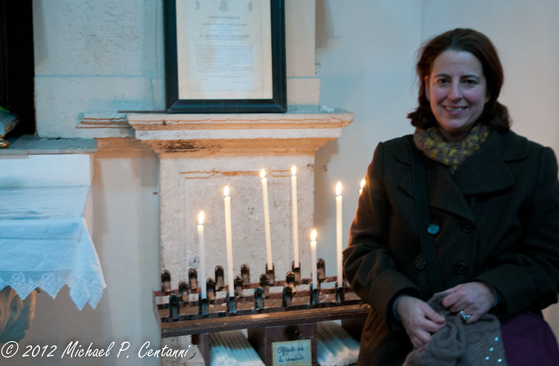 Lighting a candle in Montepulciano