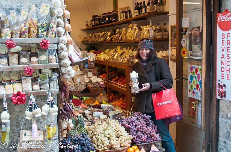 Grapes, porcino & Chianti at a shop in Siena
