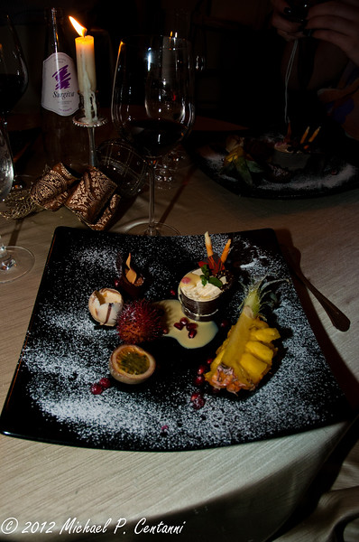 Passion fruit mousse on cookie,  Breton in vanilla sauce and Star Anise with an exotic fruit compote.