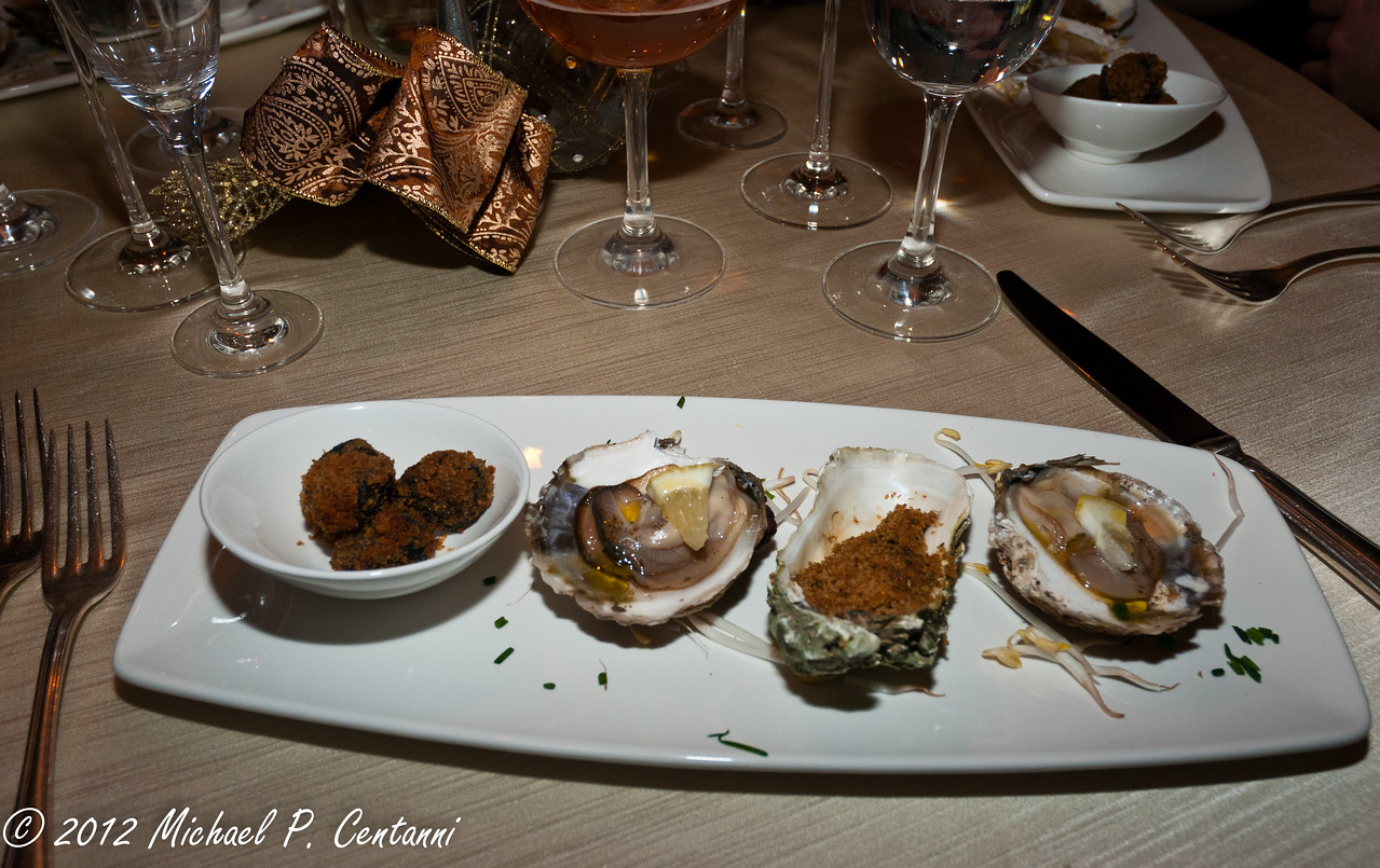 Selection of fresh oysters and escargot au gratin with aromatic herbs