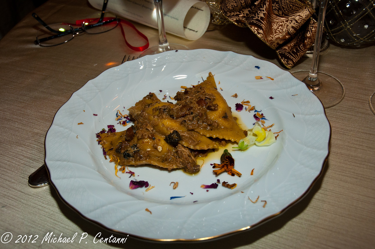 Ravioli of lentil pasta stuffed with butter and red-legged partridge in a sauce of chanterelles and morels with small flowers.