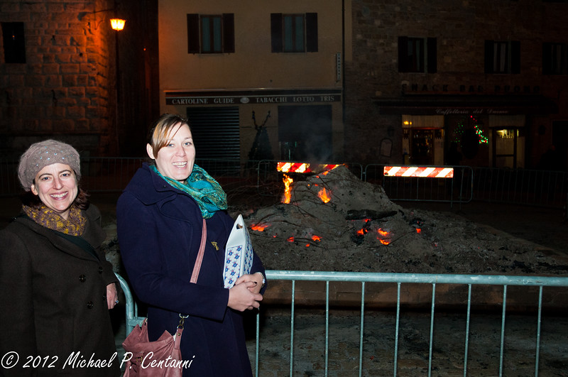 Bonfire still burning on New Years Day night on the Piazza Grande, Montepulciano