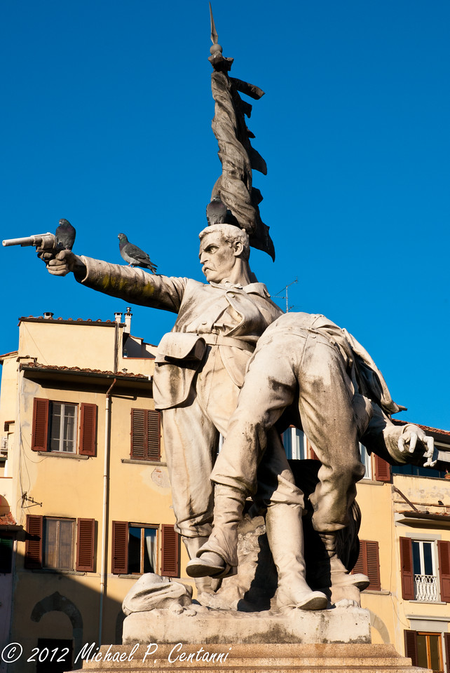 Statue along the Arno in Florence