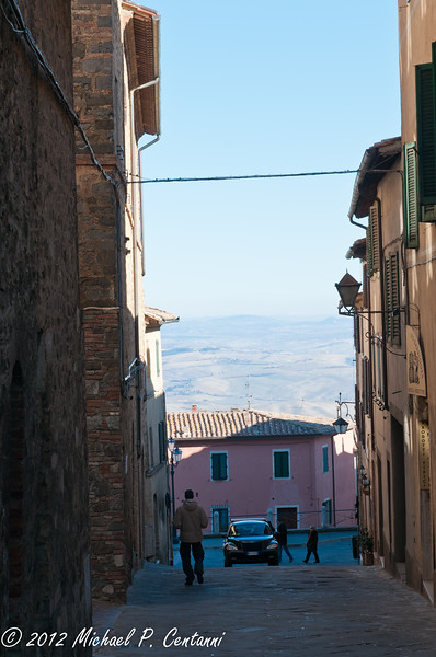 looking down a street to the countryside in Montalcino