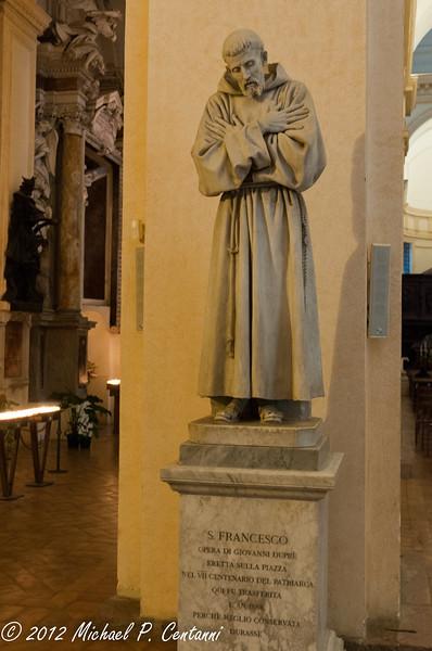 Inside San Rufino - a statue of San Francesco