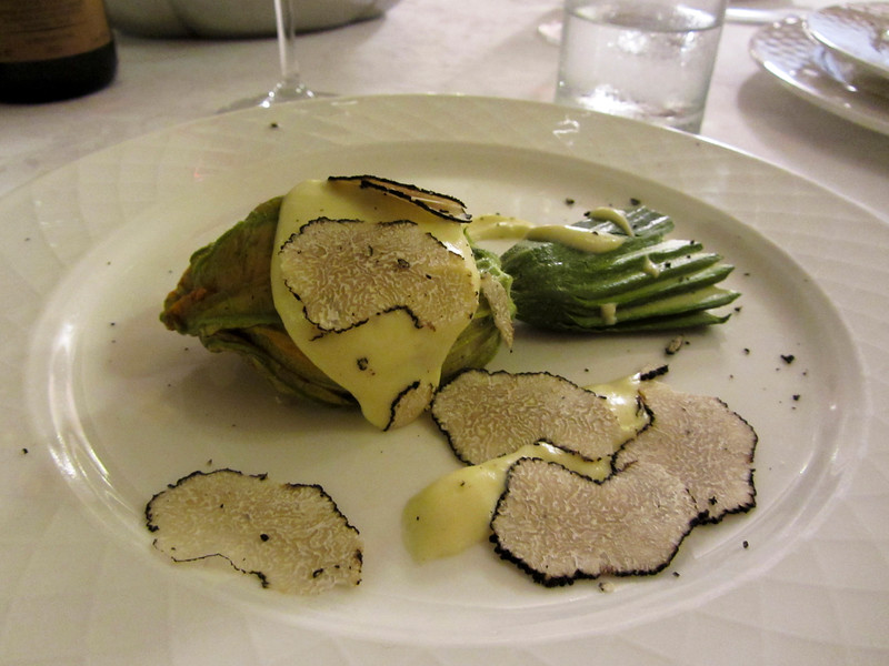 Stuffed zucchini flower with black truffles