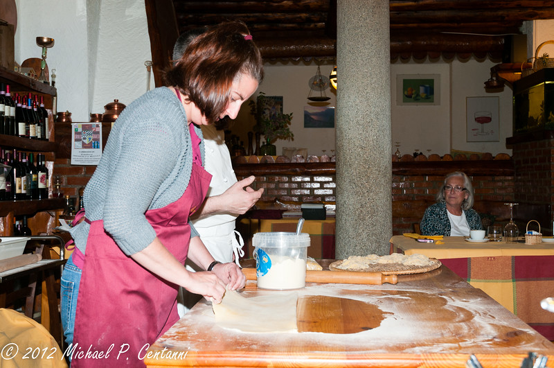 Preparing the dough to be cut into tagliatelle.