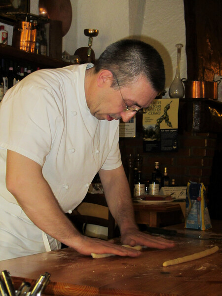 Chef Moreno of Ristorante Il Caminetto in Varenna, Lake Como<br /> <br /> Rolling dough for gnocchi