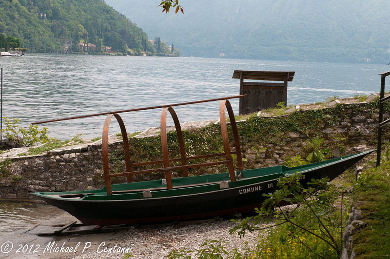 Traditional fishing boat on the shore of Comacina