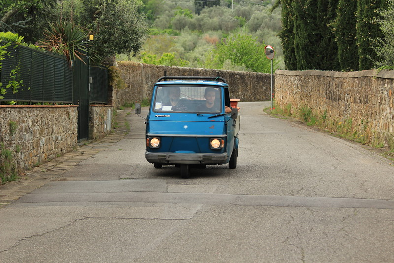 Piaggio Ape driving in countryside near Florence, Italy