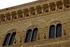 Piazza Salimbeni, Siena, 17 April 2015 2.  Heads on the 1881 Palazzo Spannocchi.