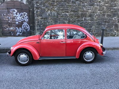 Red Volkswagen Beetle snapped in Trieste, Italy