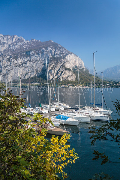 Boats in the marina at the Lake Como village of Menagio, Lombardy, Italy, Europe.