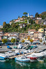 Boats in the marina at the Lake Como village of Argegno, Lombardy, Italy, Europe.