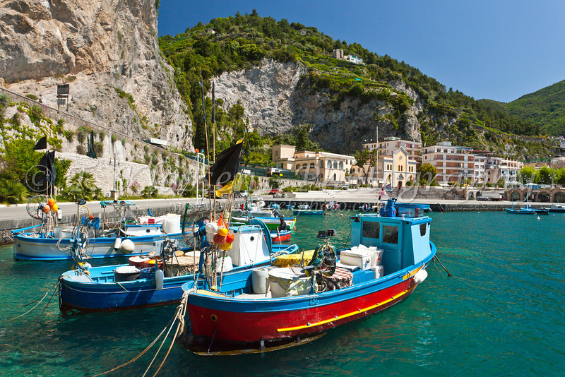 Fishing boats in the picturesque harbor of Maiori, Italy.