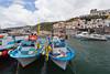 Colorful fishing boats at the small fishing village of Marina della Lobra, Sorrento, Italy.