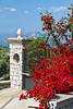 Bougainvillea flowers and a stone gate near Massa Lubrense, Italy.