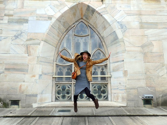 Audrey Bergner of That Backpacker dumping in front of a window at Il Duomo in Milan, Italy
