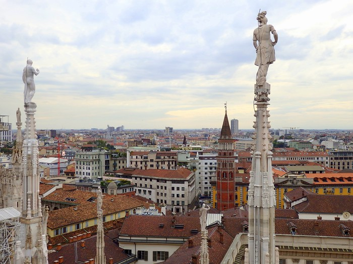 Views of the spires and of the city of Milan, Italy from high atop Il Duomo terrace.