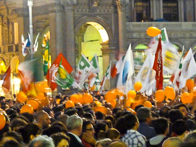 Leftist party celebrating their win in Milan's mayoral election