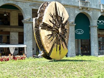 Piazza Meda arnaldo pomodoro s sun