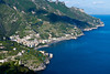 A view of terraced mountainsides and the Amalfi coast town of Minori, Italy.