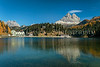 Lake Misurina with relections and fall foliage color, near Auronzo di Cadore, Dolomite Alps, Belluno, Italy, Europe.
