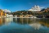 Lake Misurina with relections and fall foliage color, near Auronzo di Cadore, Dolomite Alps, Belluno, Italy, Europe.