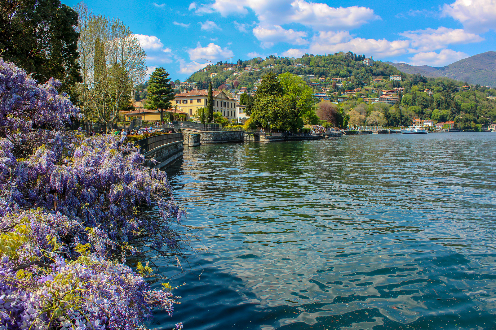 traveling alone in italy is a treat with it's lush flowers and lakes