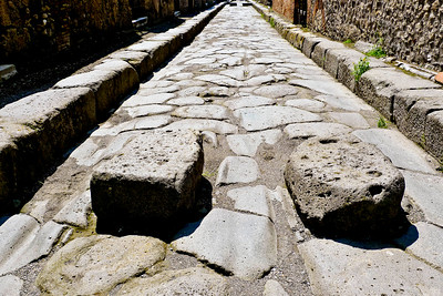 Pompeii - Stones in road to allow pedestrians to step over water and sewage in streets.