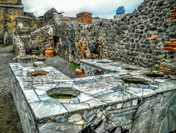 """Pompeian Hot Meal Shop"""