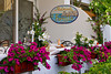 The Fornillo Restaurant sign with petunia flowers in Positano, Amalfi Coast, Italy.