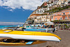 Positano, Italy and the Amalfi Coast with colorful boats on the shore.