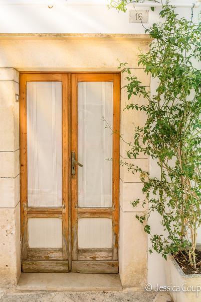 Beam of Sunlight on the Blond, Wooden Doorway