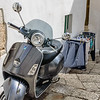 Grey Vespa With Laundry