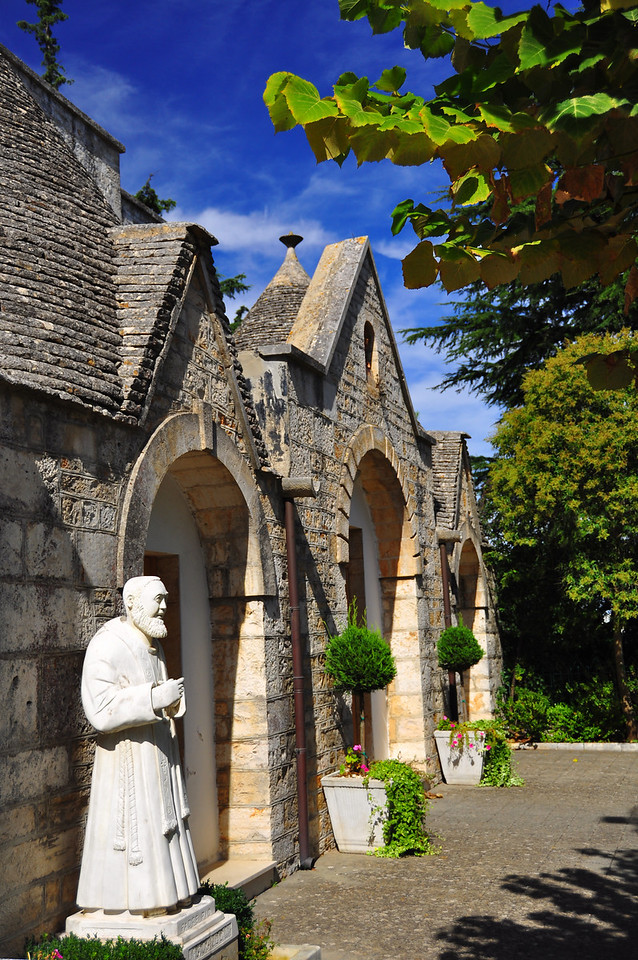 some monk and his humble chapel in Alberobello
